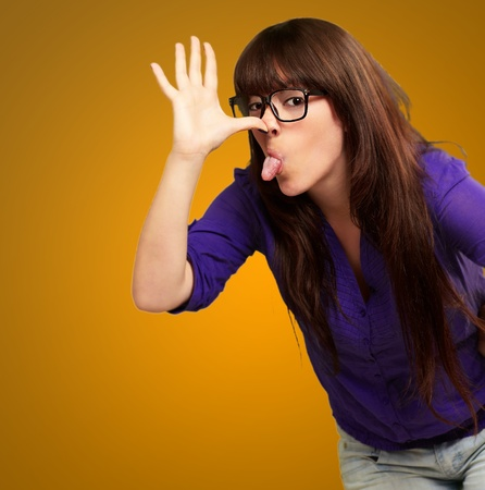 Portrait of a female making funny face on yellow background Stock Photo - 16039041