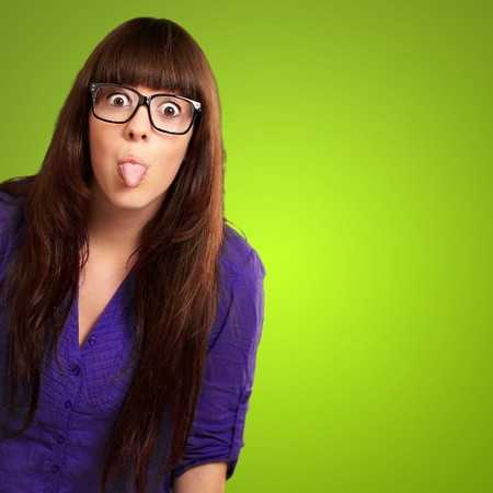 provocation: Crazy Woman With Stick Out Tongue Isolated On Green Background Stock Photo