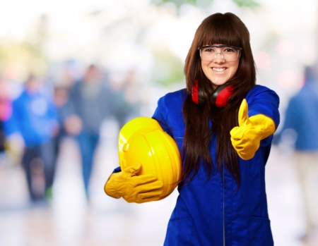handglove: Portrait Of A Young Female Worker, Background