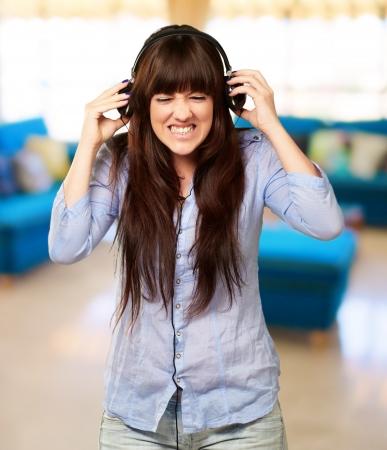 Irritate Girl listening Music, Indoor