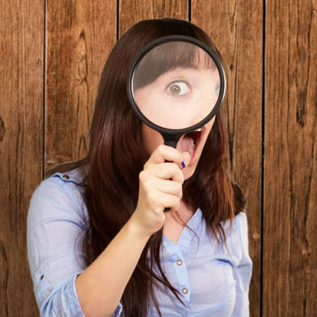 magnified: Woman Holding Magnifying Glass, Indoor