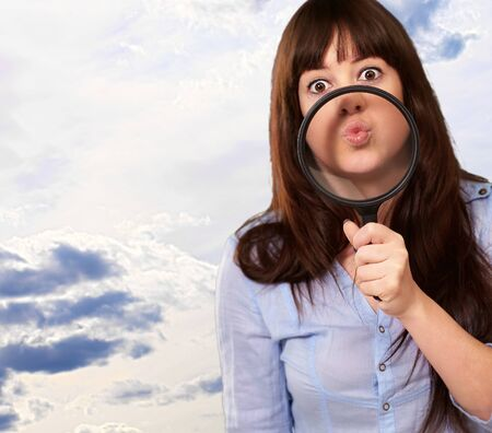 causation: Woman Holding Magnifying Glass On Mouth, Outdoor
