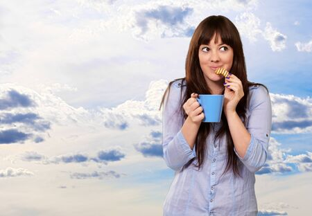 eating breakfast: Beautiful Woman With Coffee And Cookies, Outdoor