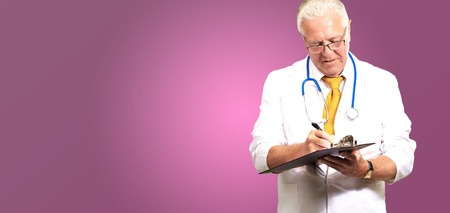 Senior Male Doctor Writing On Clipboard Isolated On Pink Background Stock Photo - 16038937