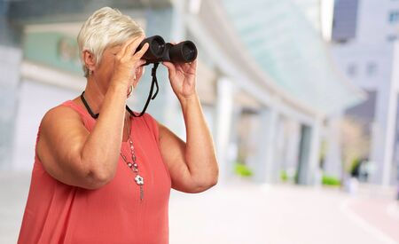 A Senior Woman Looking Through Binoculars, Outdoor Stock Photo - 16039336