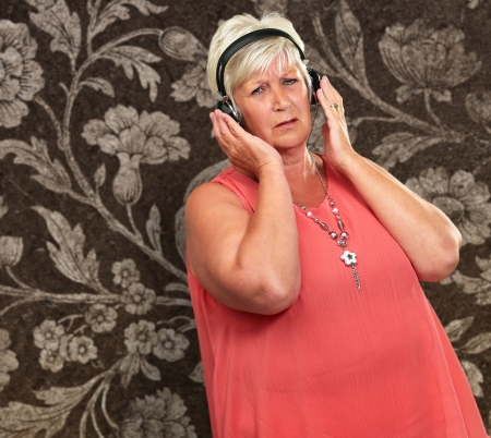 Portrait Of A Senior Woman With Headphone On Wallpaper photo
