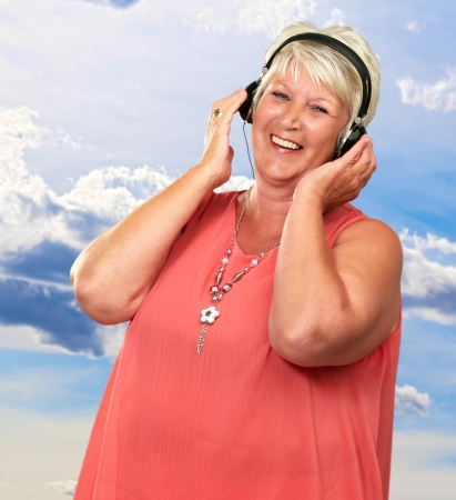 Portrait Of A Senior Woman With Headphone, Outdoor photo