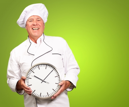 the occupant: Potrait Of Chef Showing Watch On Green Background