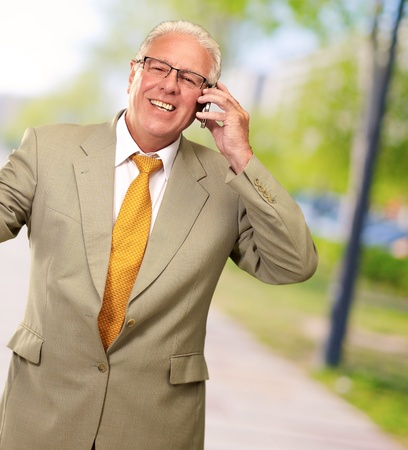 Senior Business Man Talking On Phone, Outdoor photo