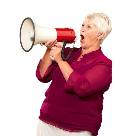 Portrait Of A Senior Woman With Megaphone On White Background photo