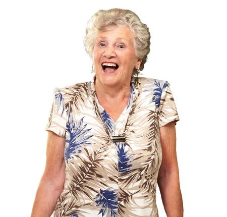 1 senior: Retrato de una mujer mayor feliz en el fondo blanco Foto de archivo