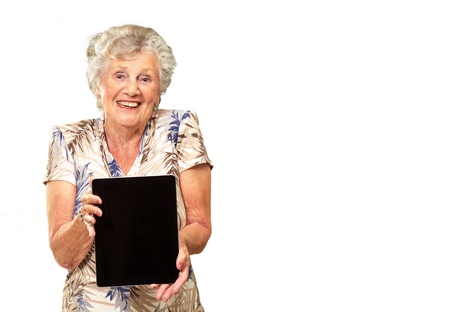 Portrait Of A Senior Woman Holding A Digital Tablet On White Background
