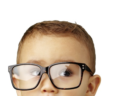 portrait of a kid wearing glasses against a white background photo