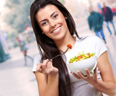 portrait of healthy woman eating salad at city Stock Photo - 16140066