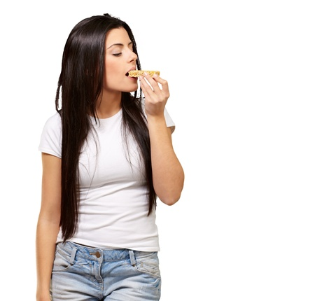cereal bar: Young Girl Eating Cereal Bar Isolated On White Background