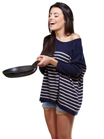 Portrait Of A Young Girl Holding A Frying Pan On A White Background photo