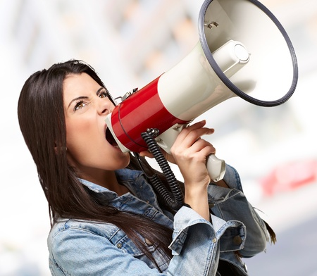 portrait of young woman screaming with megaphone indoor Stock Photo - 16252276