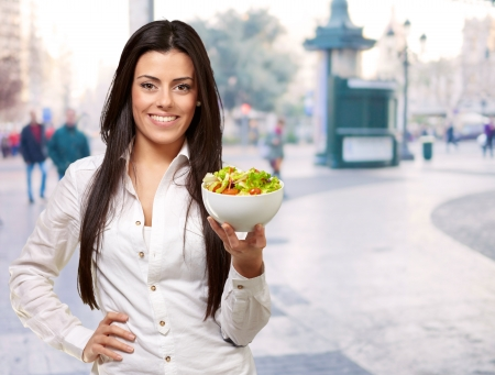 portrait of young woman holding salad at street Stock Photo - 16252304