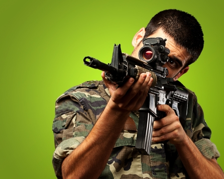 Soldier Gunman Aiming His Target On green Background Stock Photo - 16303944