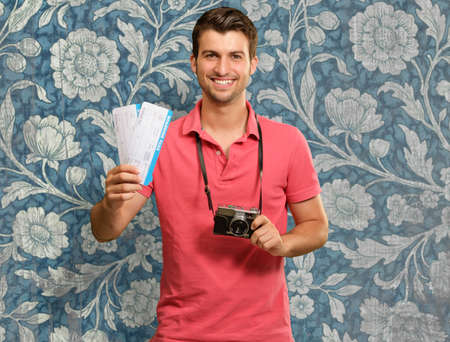 Portrait Of Man Holding Camera And Boarding Pass, Wallpaper Stock Photo - 16291112
