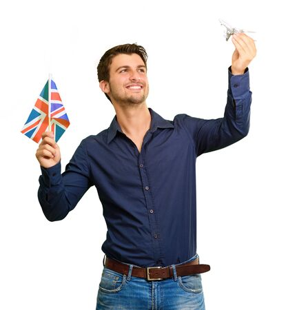 Man holding flag and miniature of airplane on white background photo