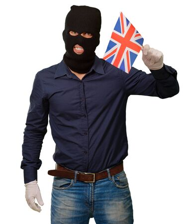 thievery: Portrait of a man wearing mask holding a flag isolated on white background Stock Photo