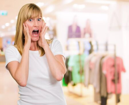 Portrait Of Shocked Woman at a clothes shop Stock Photo - 16291022