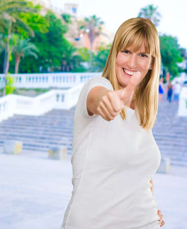 Happy Woman Showing Thumb Up, outdoor Stock Photo - 16291083