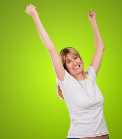 Happy Woman Cheering against a green background Stock Photo - 16289321