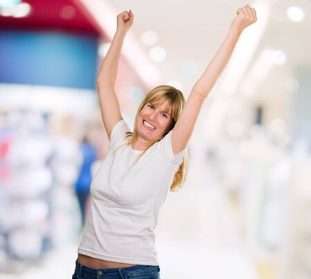 Happy Woman Cheering at a shopping center Stock Photo - 16290839