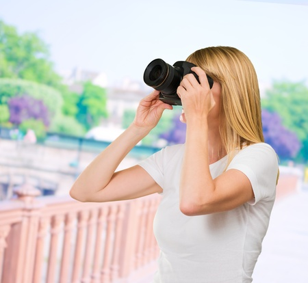 Young Woman Photographing at a bridge, outdoor Stock Photo - 16290914