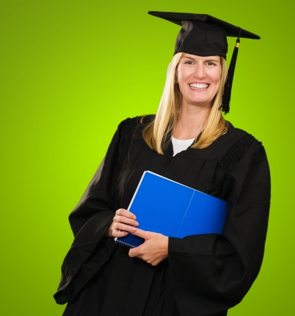 Happy Graduate Woman Holding a notebook against a green background Stock Photo - 16289501