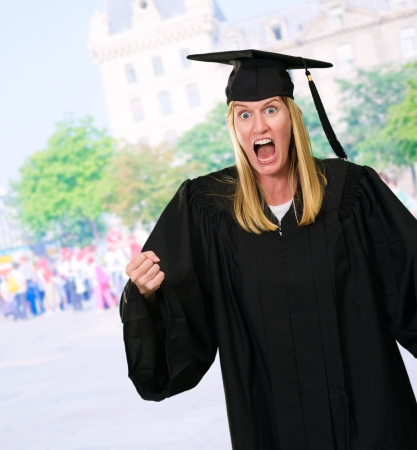 Portrait of an angry graduate against a street background Stock Photo - 16290542