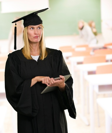 assume: Confused Graduate Woman Holding Digital Tablet at a classroom
