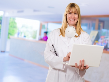 Female Doctor Using Laptop at a reception photo