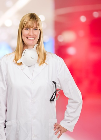 Female Doctor With Protective Mask Around Neck at an office photo
