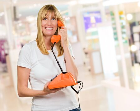 Happy Woman Holding Telephone in a shop Stock Photo - 16290079