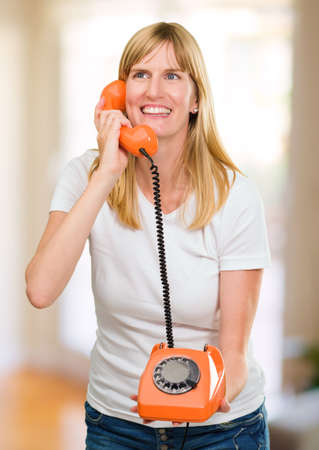 pretty woman talking on telephone against an abstract background Stock Photo - 16290769