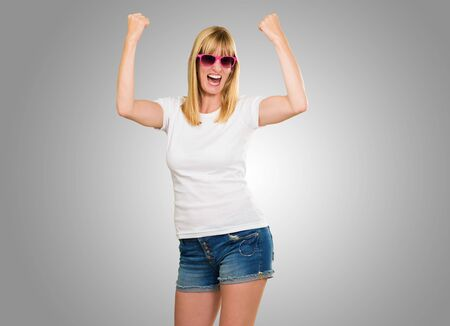 Woman Cheering against a grey background photo