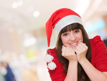 portrait of a beautiful woman wearing a christmas hat at the mall, indoor Stock Photo - 16290467