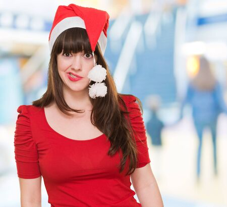 funny woman wearing a christmas hat, indoor photo