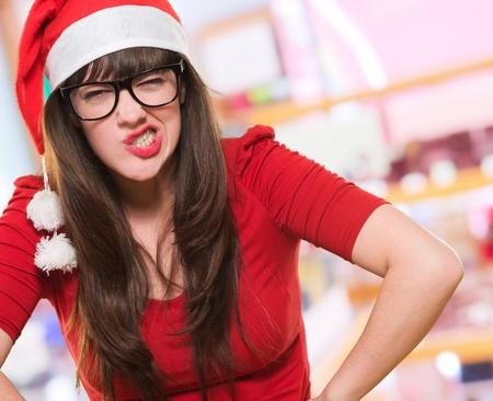 holiday stress: angry christmas woman wearing glasses at a shop
