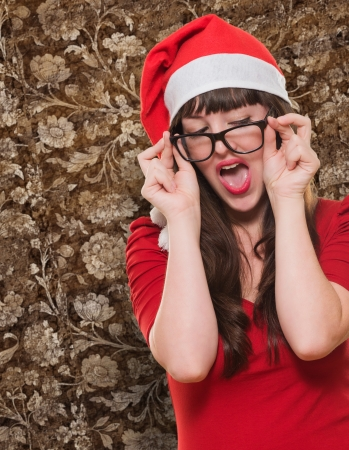 sexy christmas woman wearing glasses against a vintage background photo