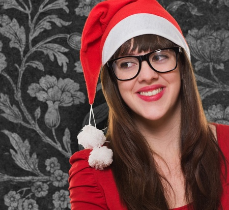 happy christmas woman wearing glasses and looking to a side against a vintage background Stock Photo - 16289455
