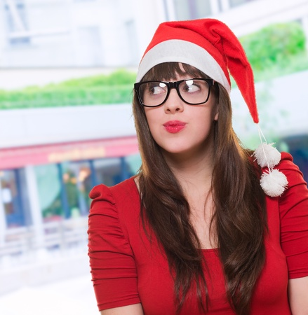 christmas woman wearing glasses and looking up, outdoor Stock Photo - 16290672