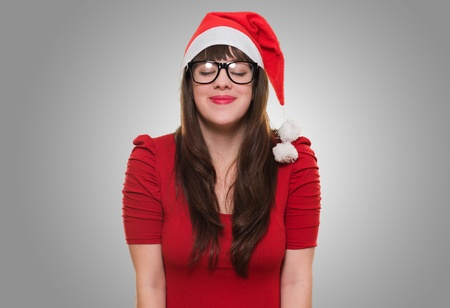 christmas woman wearing glasses and making a wish against a grey background Stock Photo - 16290878
