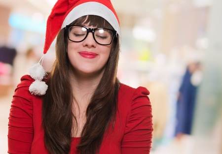 christmas woman wearing glasses and making a wish, indoor Stock Photo - 16290458