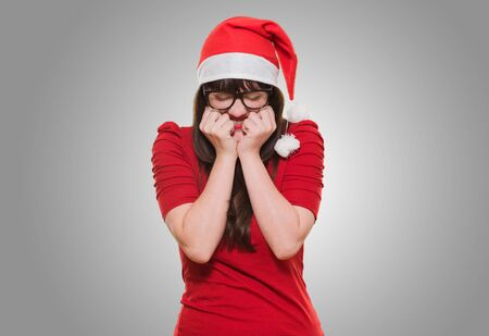 shut down: excited christmas woman with her eyes shut against a grey background Stock Photo
