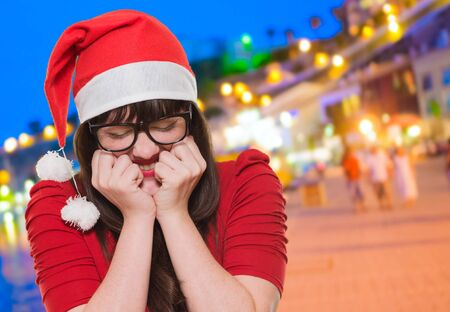 excited christmas woman with her eyes shut, outdoor Stock Photo - 16290457