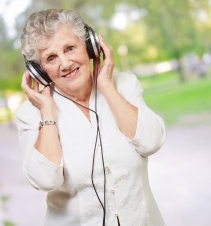 Portrait Of A Woman, While Listening Music, Outdoor photo